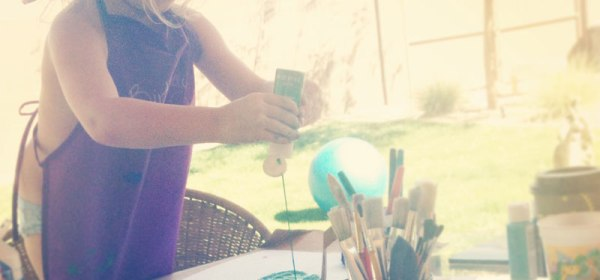 little girl painting outside